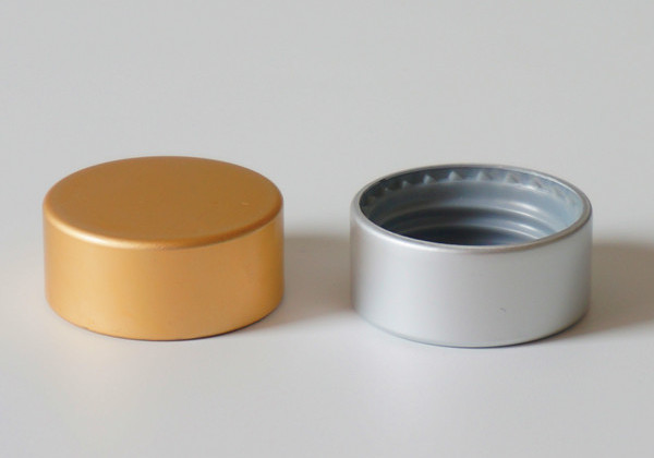 anodized aluminum and plastic cap for lotion bottle