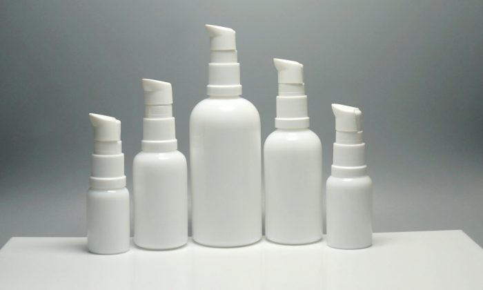 opaque white glass bottles with treatment pump for cosmetic oils