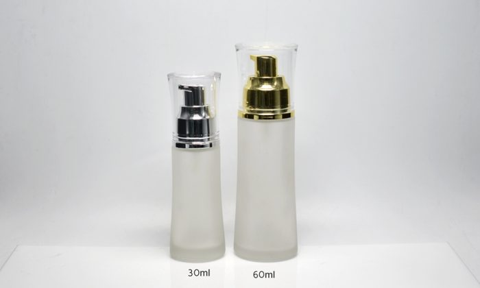 glass bottle with pump for cosmetics and skin care products