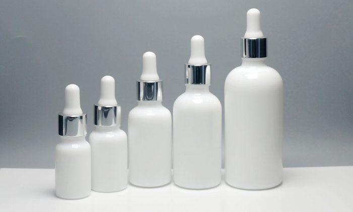 opaque white, porcelain white glass bottles with dropper for skin essence oils, hair oils, argan oils packaging