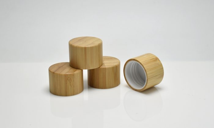 plastic cap assembled with bamboo cover for cosmetic bottles