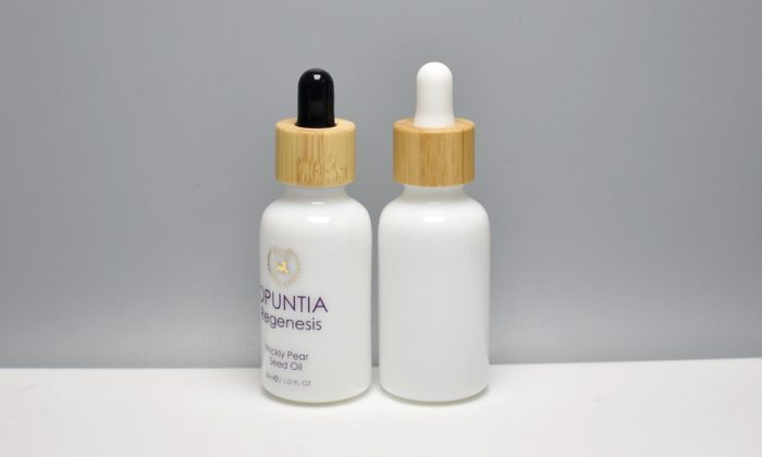 opaque white glass cosmetic bottles matched with glass dropper which assembled with bamboo collar